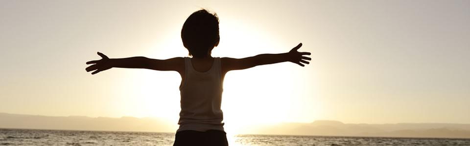 Boy embraces the sunset
